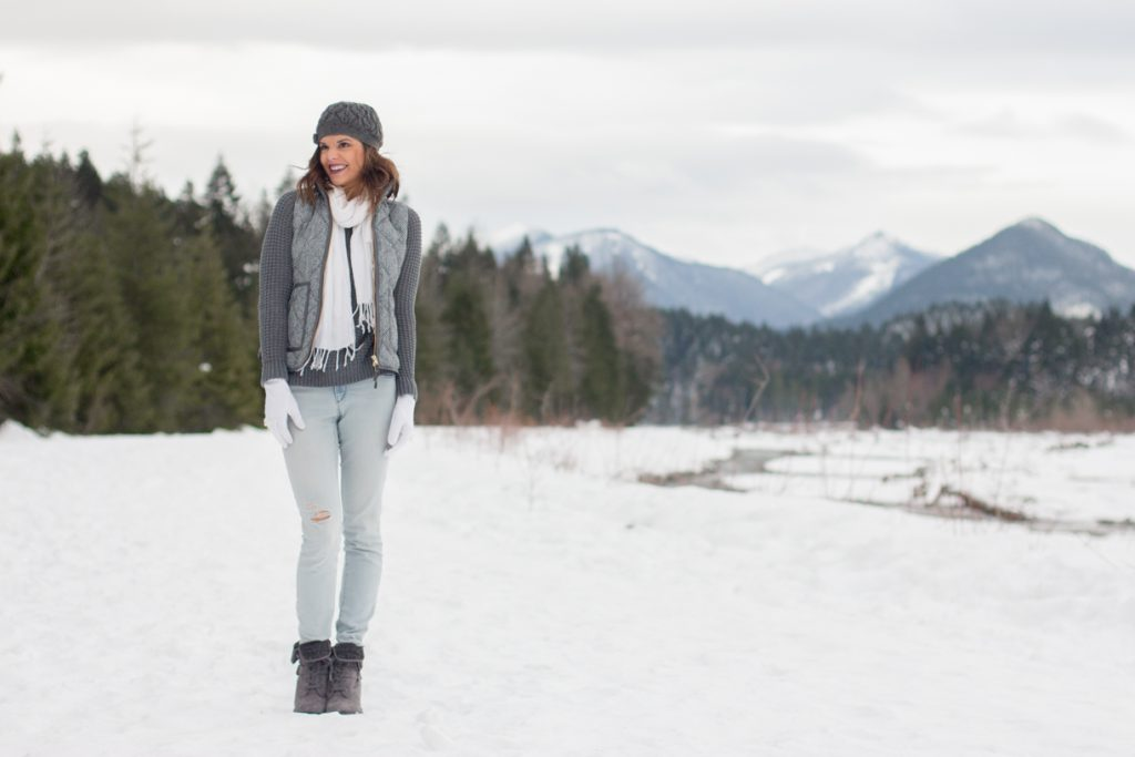 Gray and white winter layering with a scarf and vest