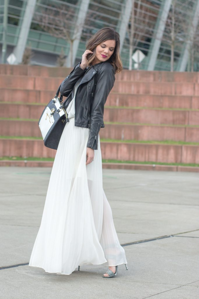White maxi dress and black faux leather moto jacket
