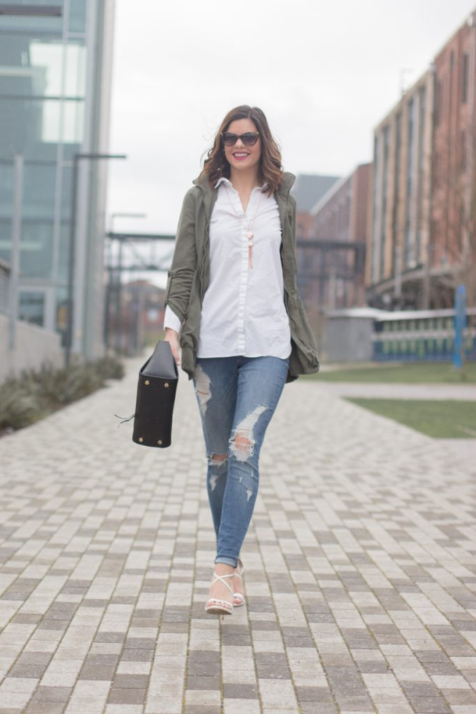 Weekend chic in distressed denim, heels, and a military jacket