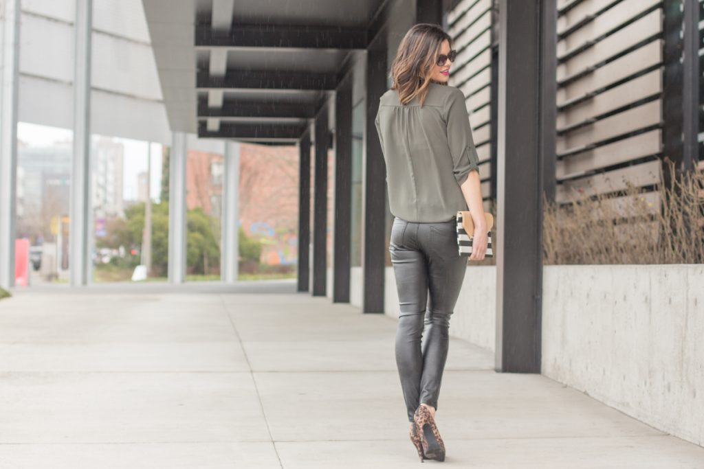 Leather leggings, olive green tunic, striped clutch, and leopard print heels