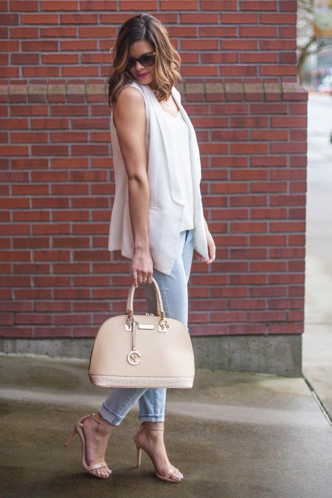 White Sleeveless Blazer with Light Denim and Tan Heels and Purse