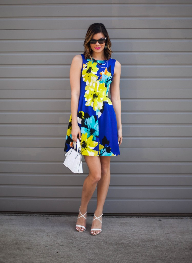Spring fashion - fit and flare dress with a mini bag